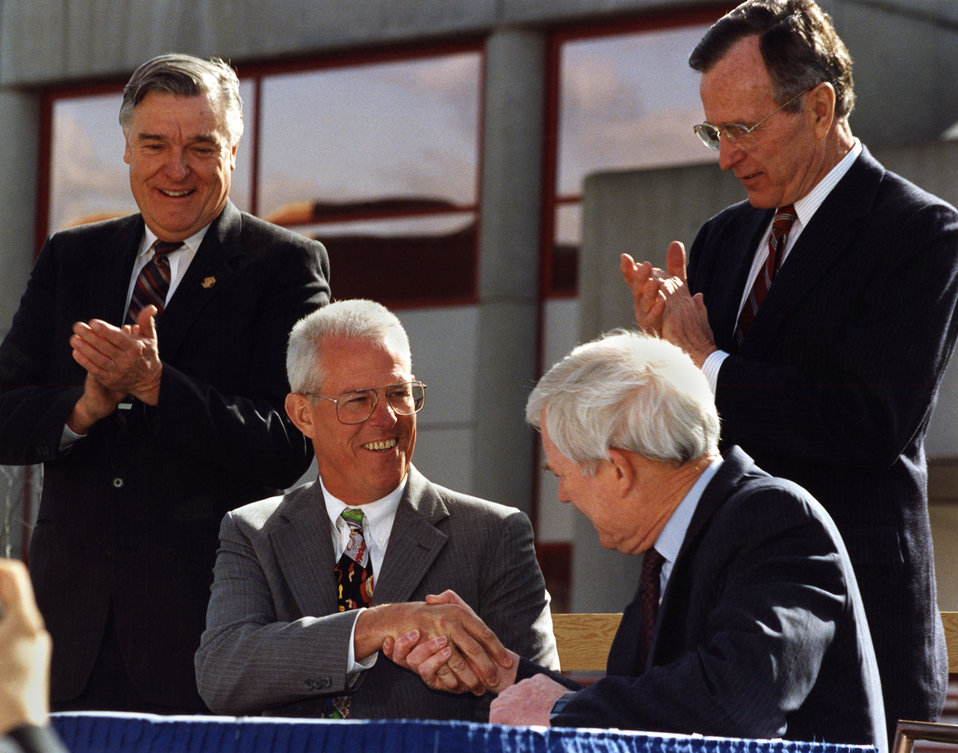 Admiral James Watkins Secretary of Energy, Joe Coors (President and Chairman of Coors Ceramics), Al Trivelpiece (Dir. of Oak Ridge National Lab.) and President George Bush Sr