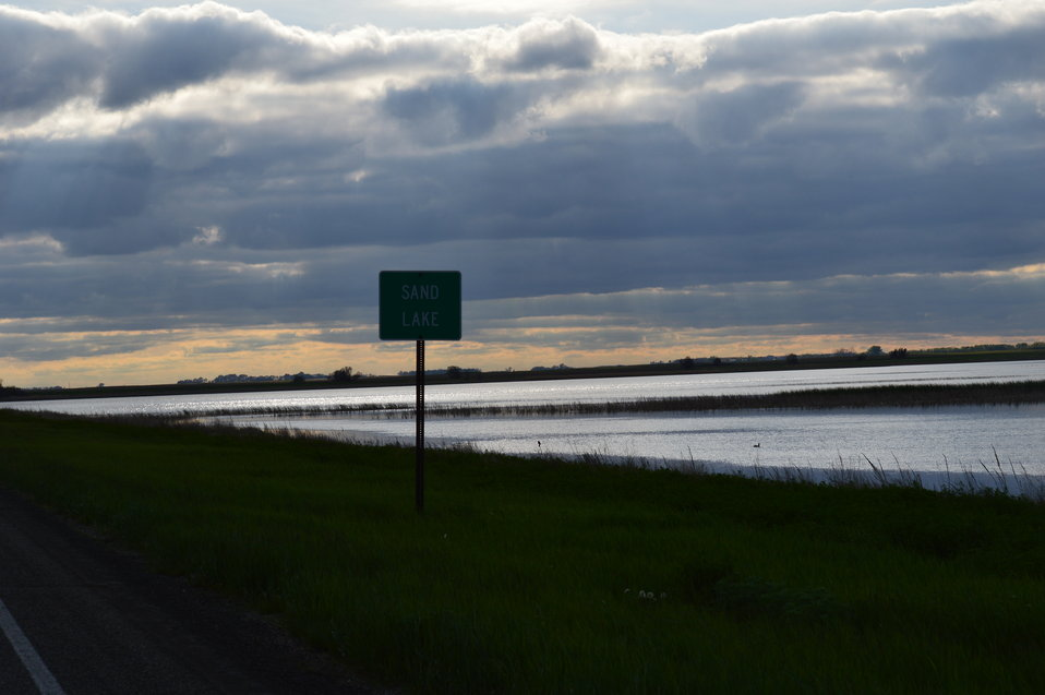 'Sand Lake' sign at dusk