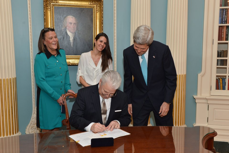 Assistant Secretary Starr Signs His Appointment Papers