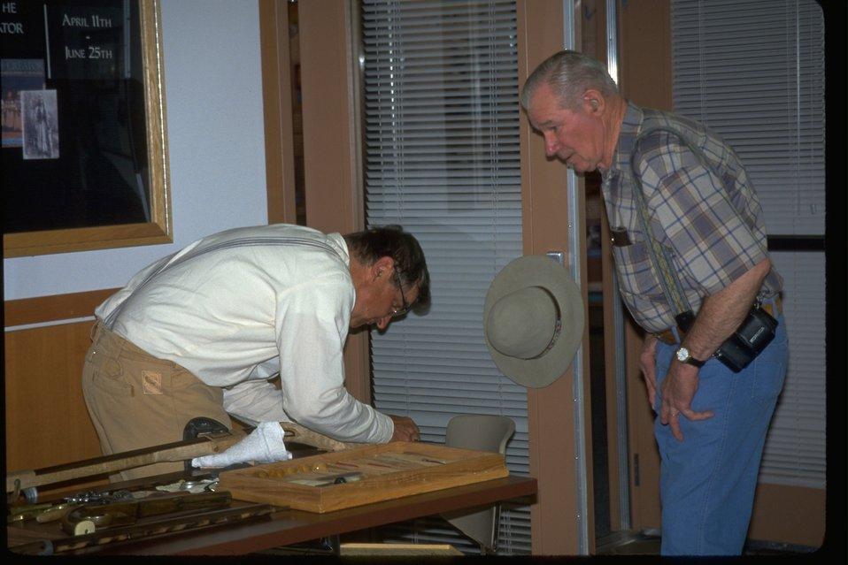 Dick Micha demonstrating gunsmithing to visitors at the NHOTIC.