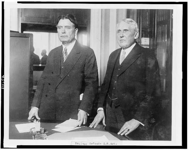 Frank B. Kellogg, right, U.S. Secretary of State