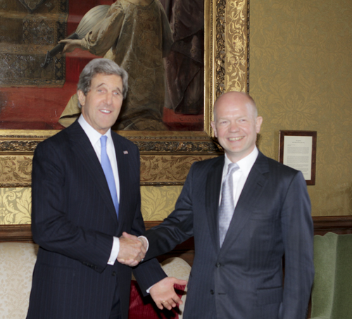 Secretary Kerry Shakes Hands with UK Foreign Secretary William Hague