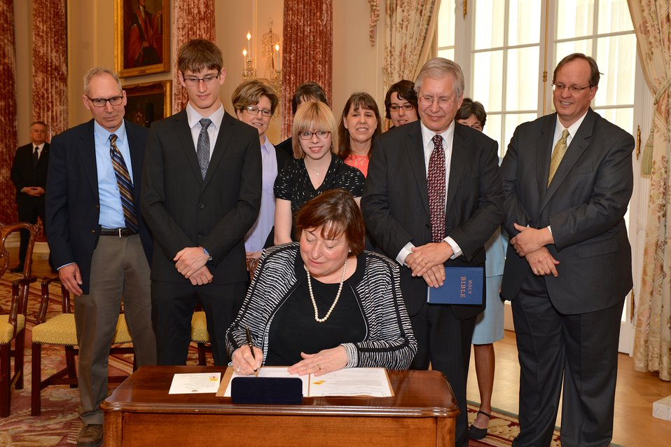 Under Secretary Novelli Signs Her Appointment Papers