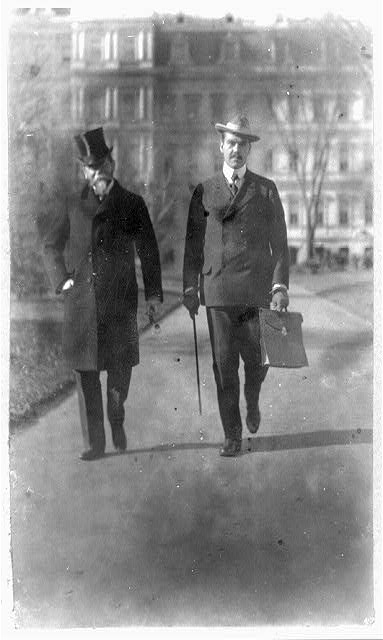 John Hay, U.S. Secretary of State, left, walking with his son.