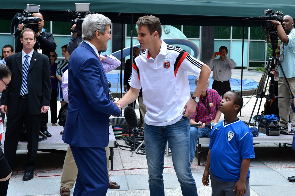 Secretary Kerry Chats With a DC United Player
