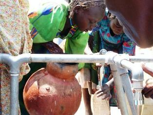 A Chadian IDP Girl Fetches Water