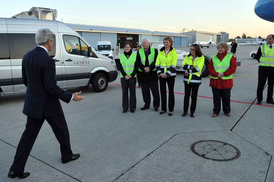Secretary Kerry Greets Ramp Workers Before Departing Geneva International Airport