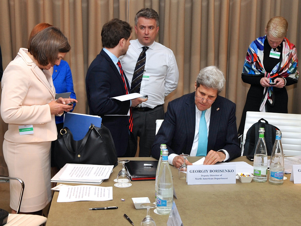 Secretary Kerry Puts Final Touches on Remarks Before News Conference in Geneva