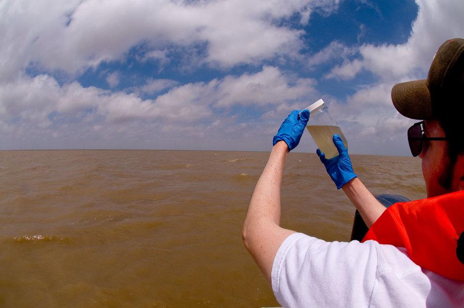 Murky water, checking turbidity.