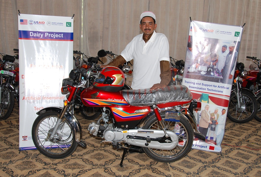 A successfull AI technician with his new motorcycle awarded by USAID Dairy Project5