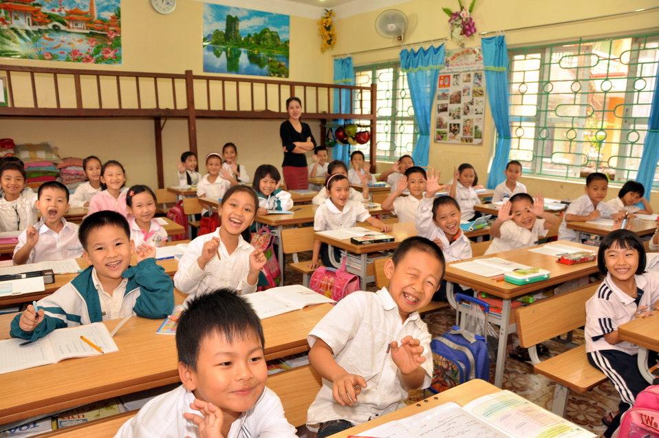 School children receive a dose of deworming medicine in Dien Bien