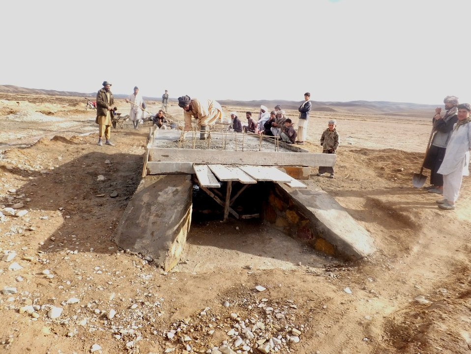 Laborers working to construct a culvert in Neyazai-ha village in Muqur D...