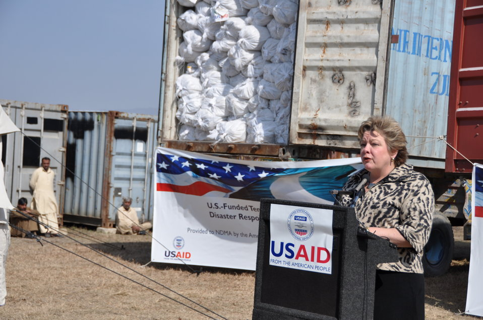 U.S. Agency for International Development (USAID) Deputy Director Karen Freeman speaks at the handover of U.S.-funded tents to support Pakistan's disaster preparedness.