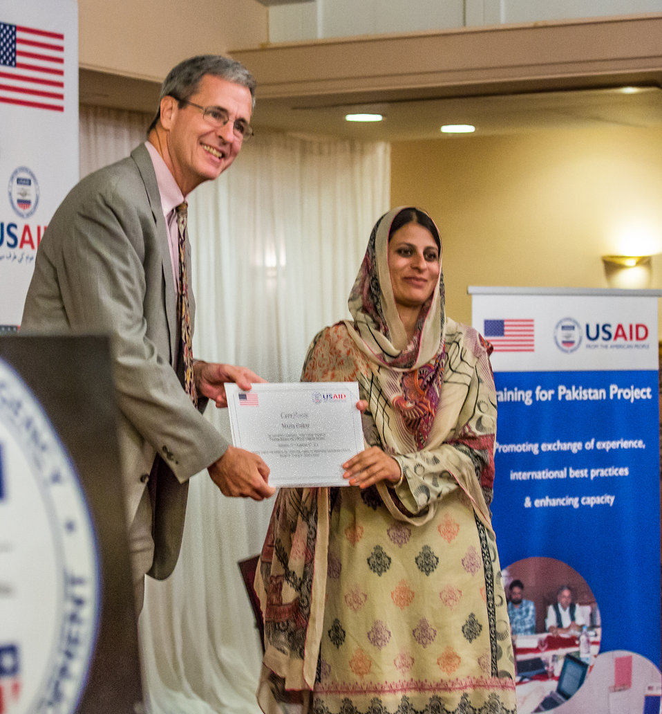 Islamabad, September 26 2012 - Jonathan Conly, USAID Pakistan Mission Director, presenting a certificate to a participant of the training program.