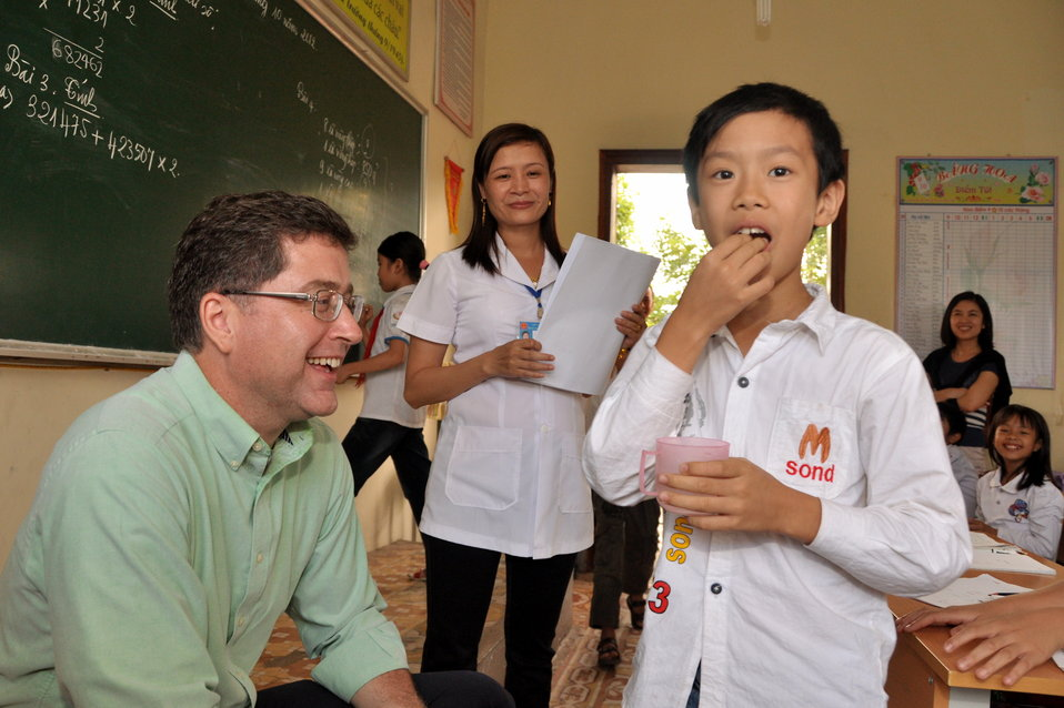 School children receive a dose of deworming medicine in Dien Bien