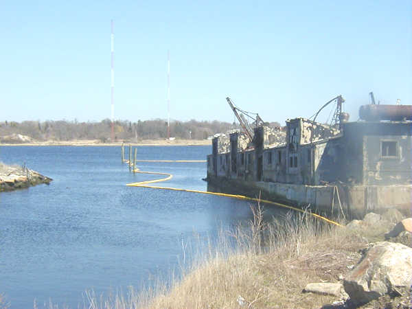 Spring 2002, oil boom to protect the harbor during vessel demolition