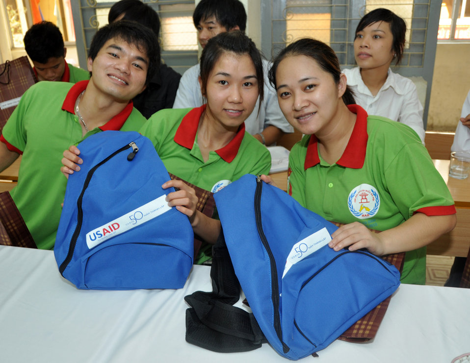 Hearing Impaired Student Graduation in Hanoi, with USAID 50th anniversary bags