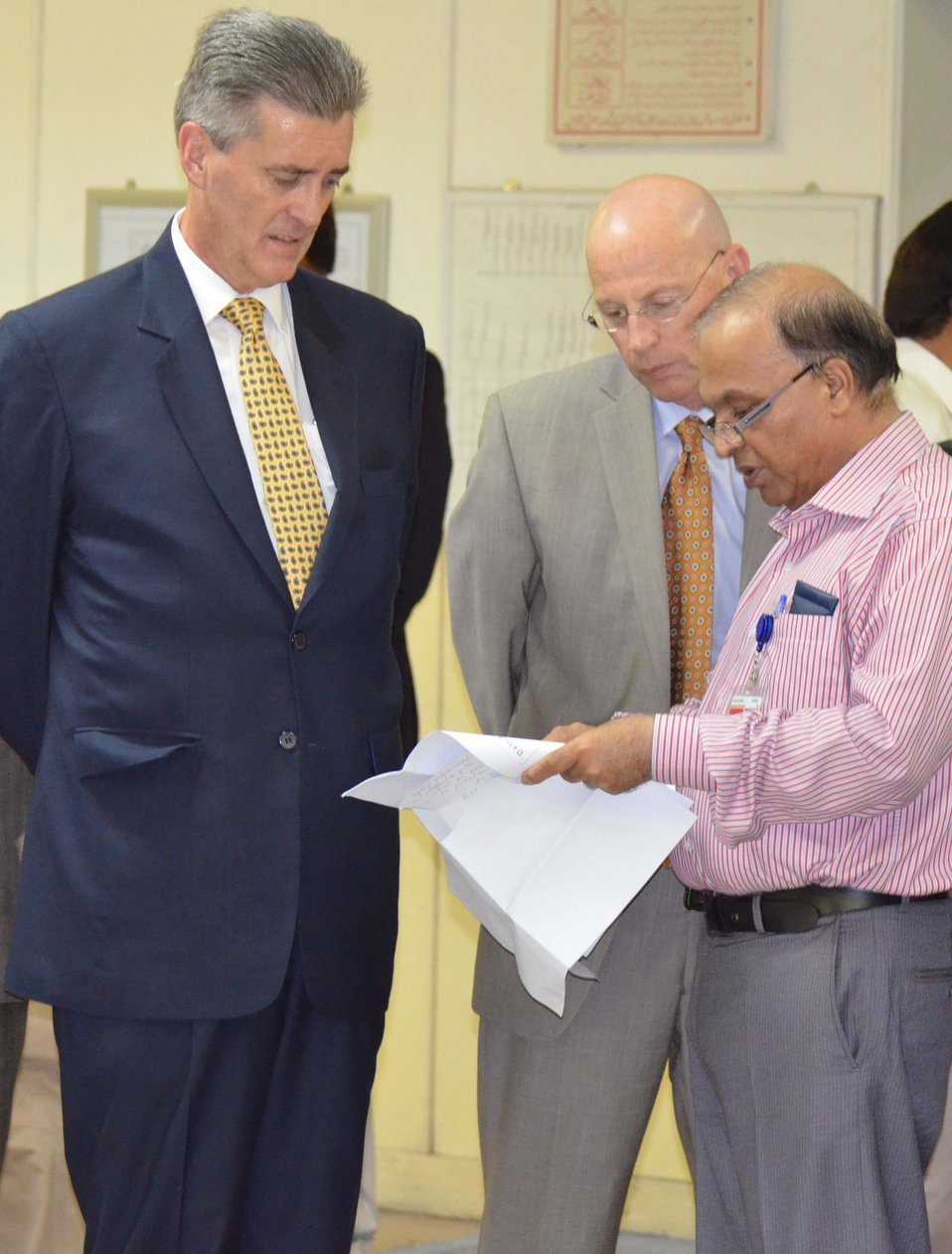Ambassador Olson and USAID Mission Director Gregory Gottlieb being briefed by Sultan Zafar, CEO Genco Holding Company Limited