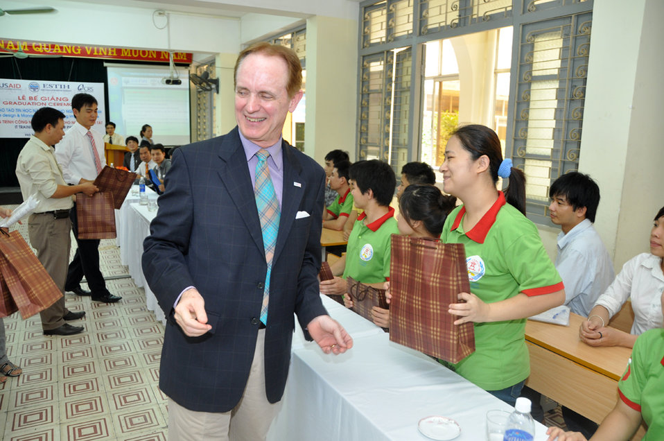 USAID Mission Director Francis Donovan participates in graduation of IT students in Hanoi on June 22, 2011.