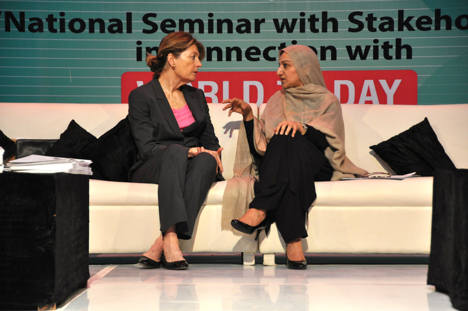 During a quiet moment between speakers, Nancy Estes, Acting Mission Director USAID, has a private conversation with Minister of State, National Health Services, Mrs. Saira Afzal Tarar.