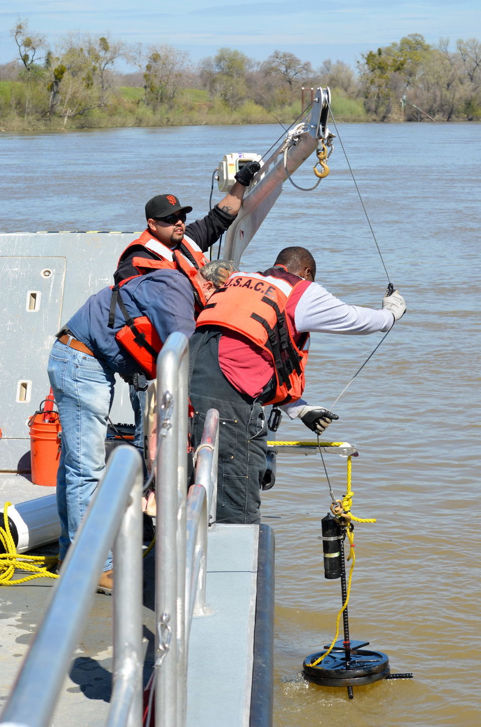 Deploying an acoustic receiver into the Sacramento River