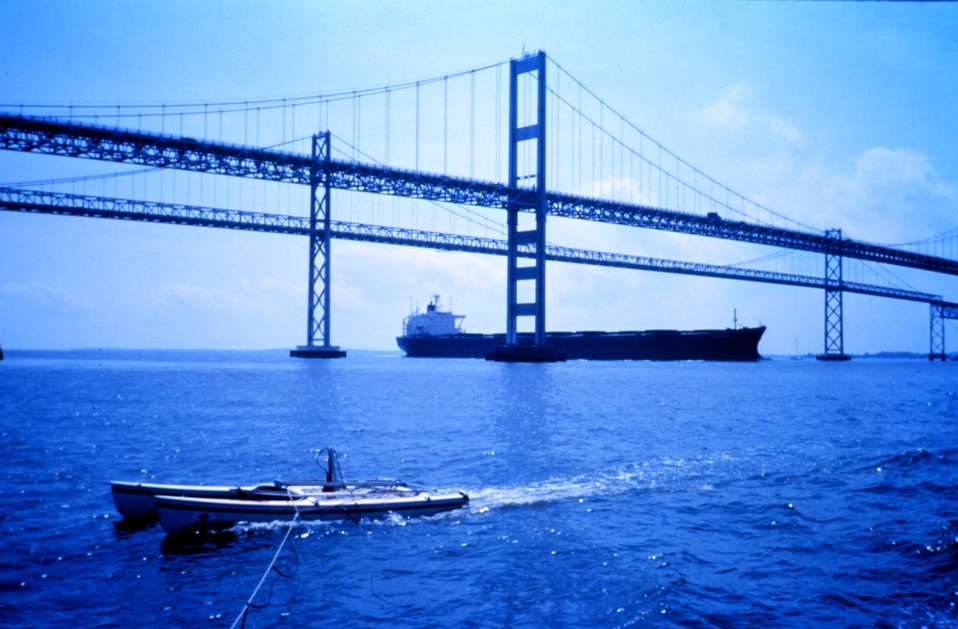 A modified catamaran takes mobile current profiles with an acoustic digital current profiler (ADCP) as a large bulk carrier passes under the Chesapeake Bay Bridge heading up the bay.