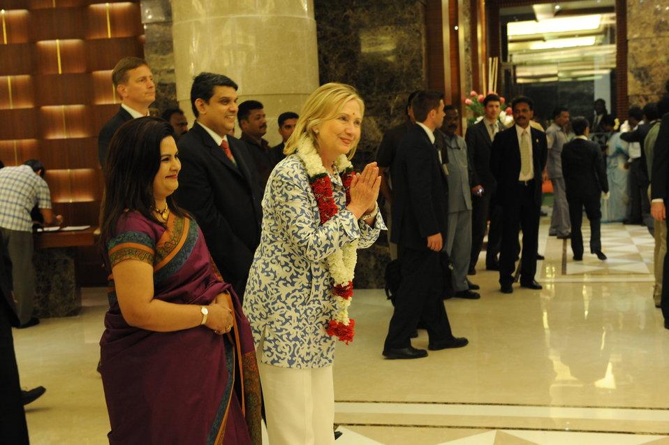 Secretary Clinton Is Greeted By Taj Coromandel Employees