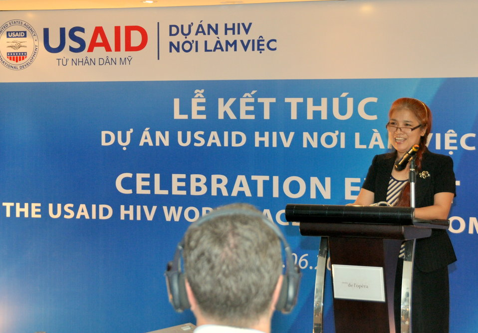 Mrs. Pham Hoai Giang of USAID HIV Workplace Project speaks at the completion event.