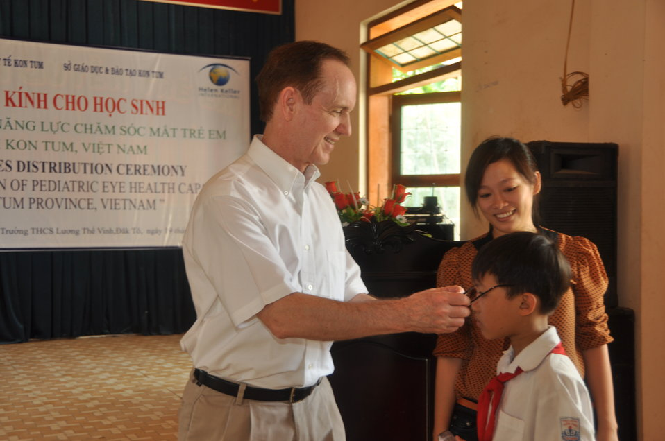 School children in Dak To, Kon Tum Province, receive eyeglasses under a program supported by USAID and partners HKI and World Learning