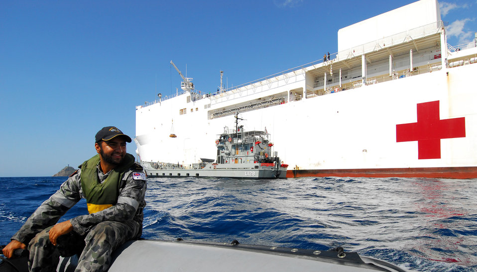 Royal Australian Navy Able Seaman Marine Technician Mead Operates a Zodiac
