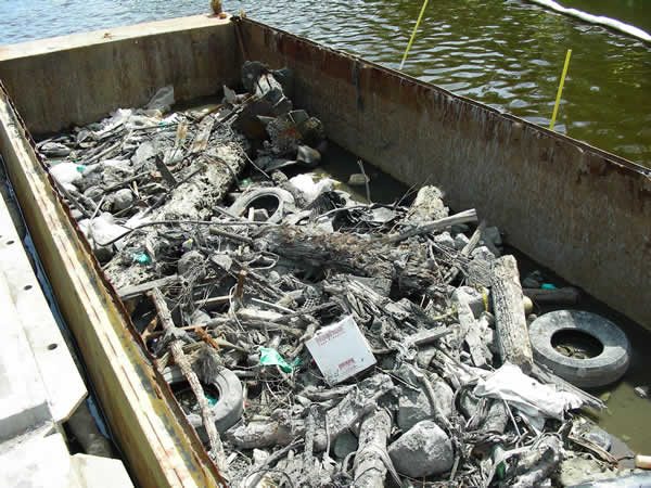 July 2009, Debris collected to ensure efficient dredge operations