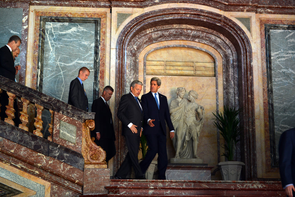 Secretary Kerry Walks With Belgian Foreign Minister Reynders