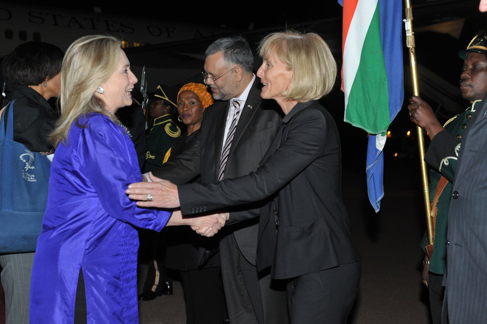 Secretary Clinton Is Greeted By Mrs. Liz Berry Gips