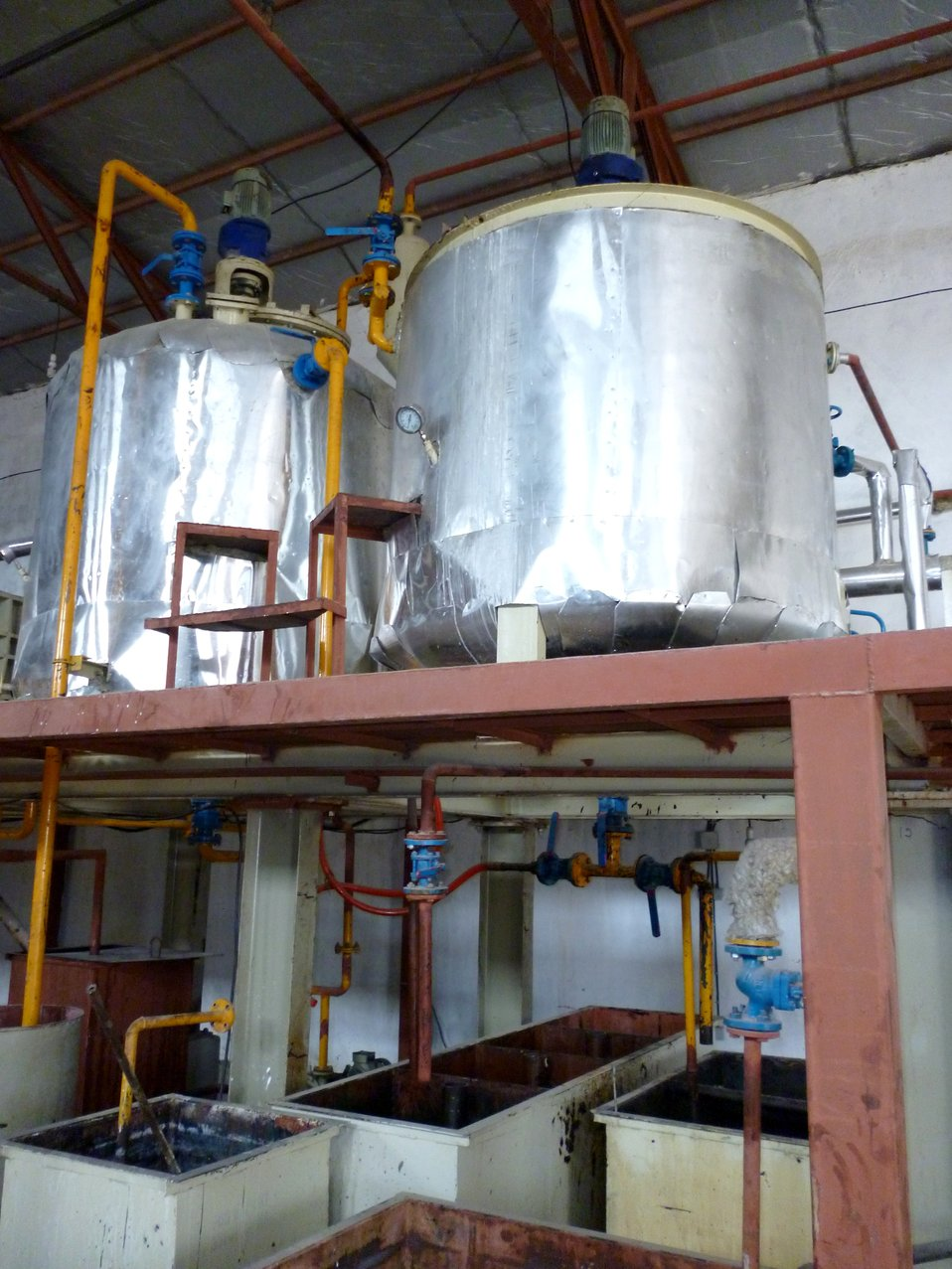 Valuable cottonseed oil is run through a series of vats and filters during the refining process.