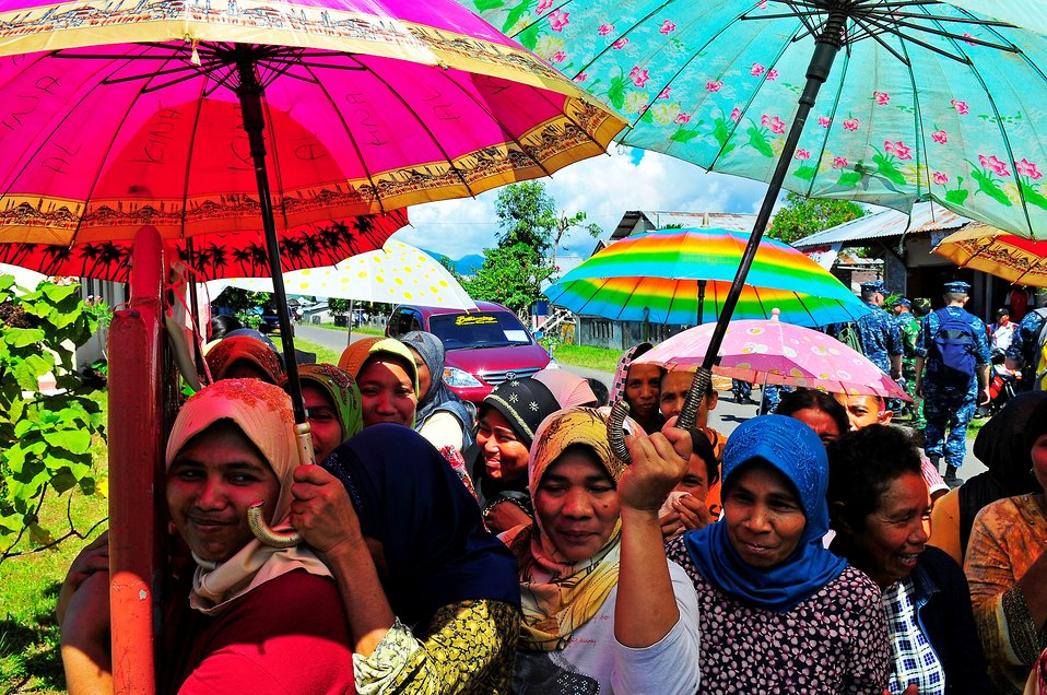 Local Indonesians Wait To Receive Medical Screening and Treatment