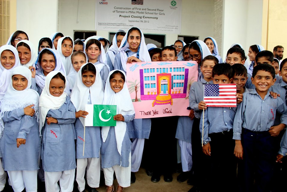 School children pose with a thank you card for USAID