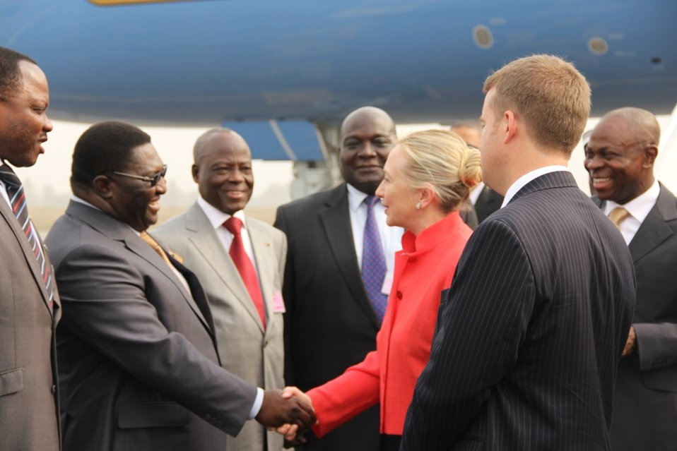 Secretary Clinton Is Greeted By Togolese Territorial Administration Minister Pascal Bodjona