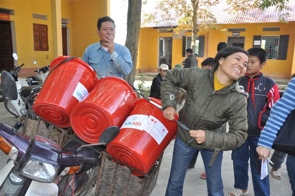 USAID provides household kits to families affected by flooding near Hanoi