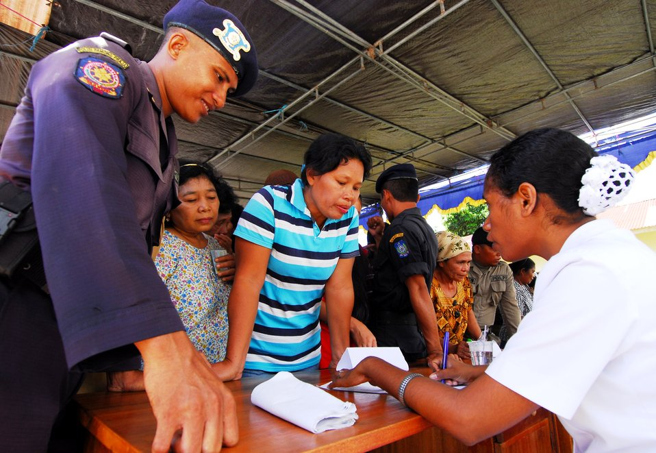 A Patient Checks in To Receive Medical Screening and Treatment