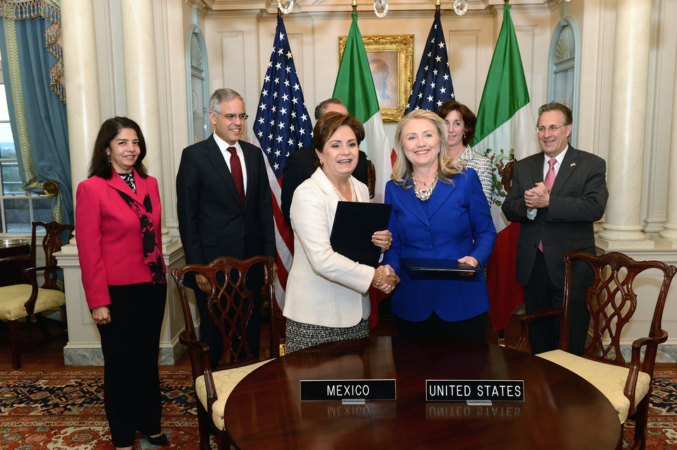 Secretary Clinton and Mexican Foreign Relations Secretary Espinosa Shake Hands