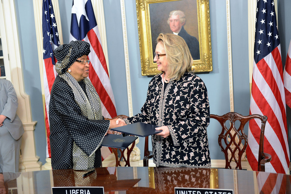 Secretary Clinton Shakes Hands With Liberian President Sirleaf