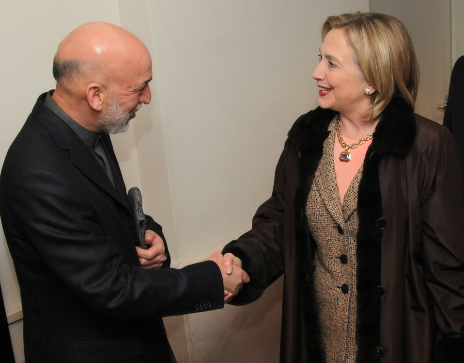 Secretary Clinton Shakes Hands With Afghan President Karzai