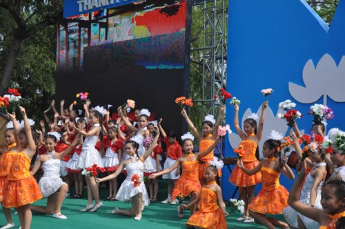 Children perform during Hanoi's 1,000th anniversary celebrations.