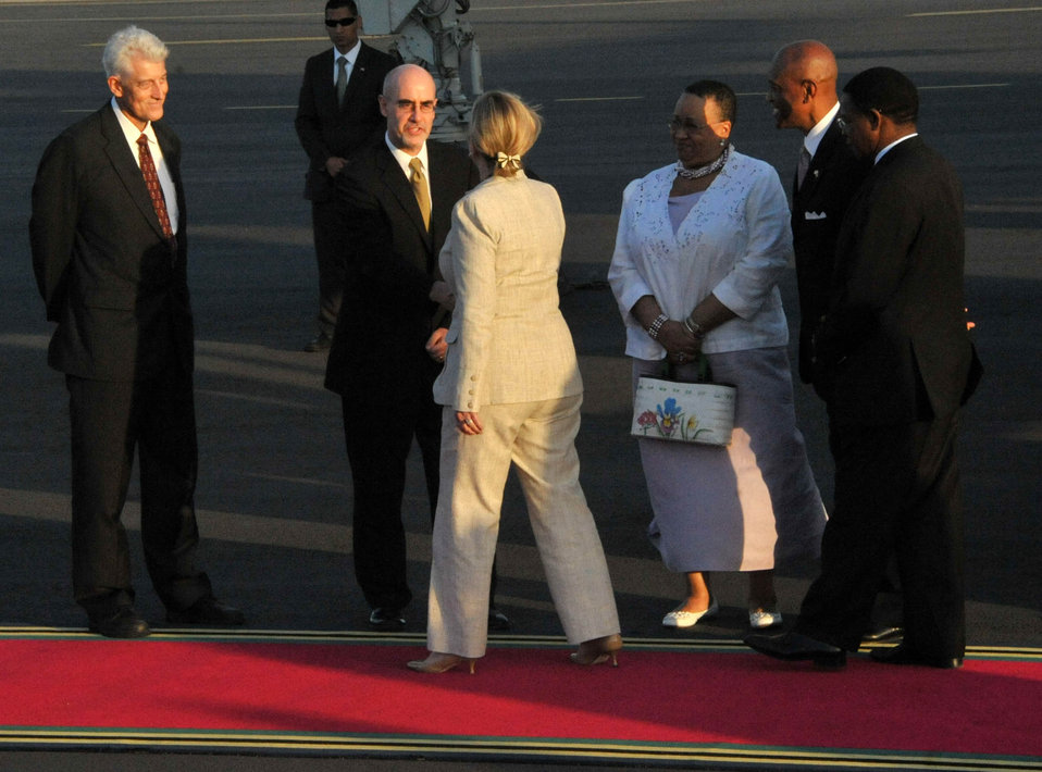 Secretary Clinton Is Greeted By Deputy Chief of Mission Scott