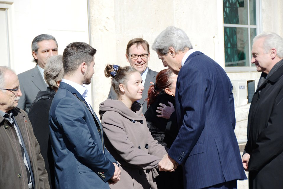 Secretary Kerry Shakes Hands With a Family Member of Embassy Guard Akarsu
