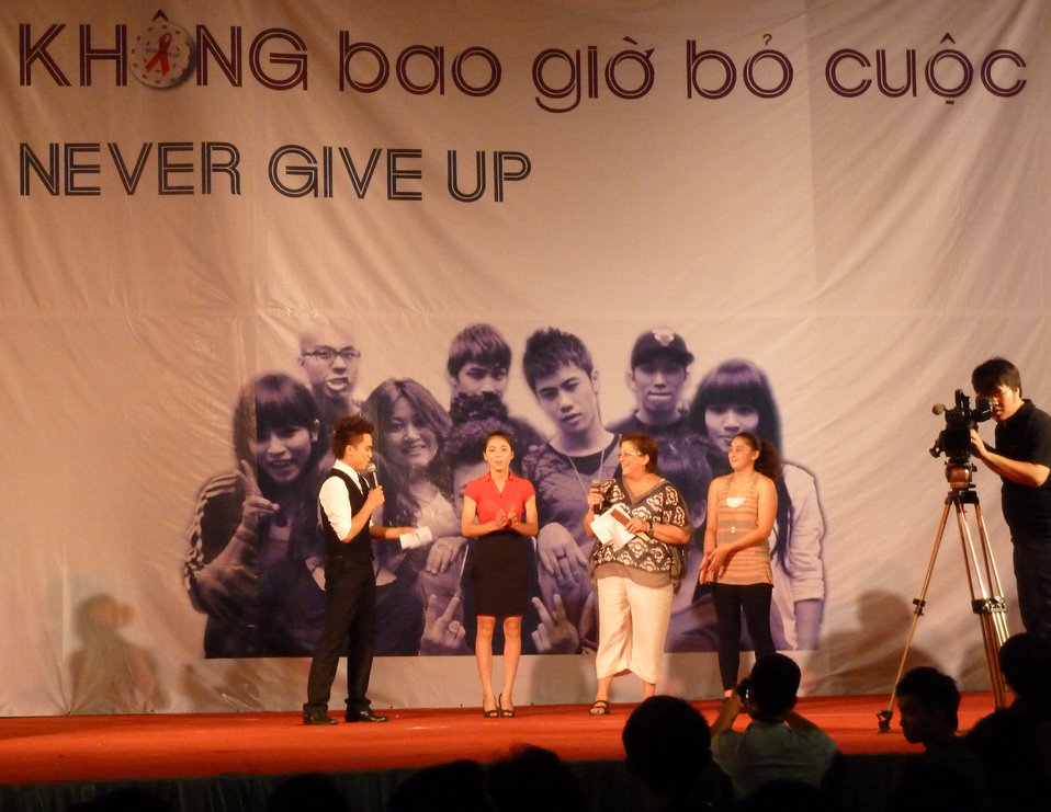 U.S. Embassy Deputy Chief of Mission Claire Pierangelo raps on state to the hip hop against HIV/AIDS beat.