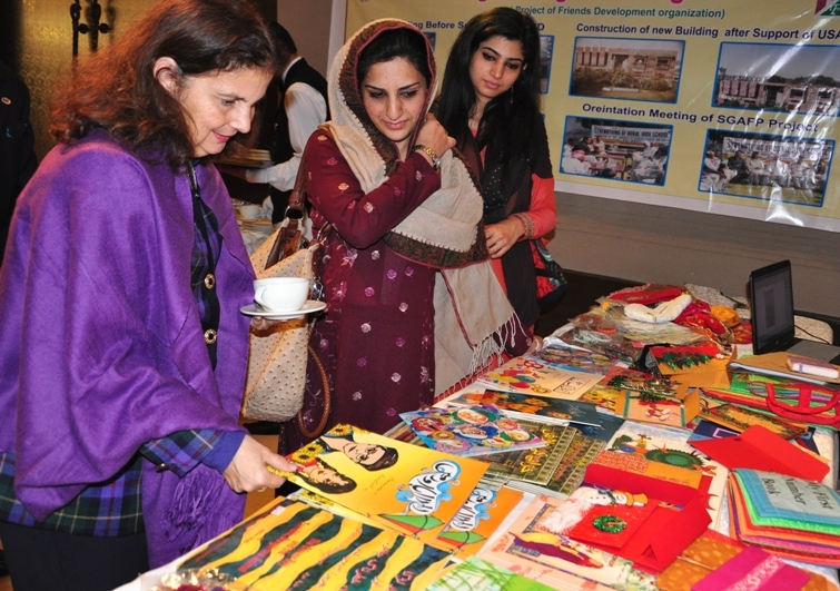 U.S. Consul General Nina Fite browsing through various education material on Alif Laila Book Bus Society stall.