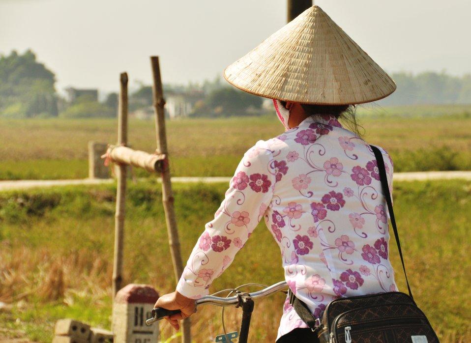 A woman rides her bike near Dien Bien, Vietnam