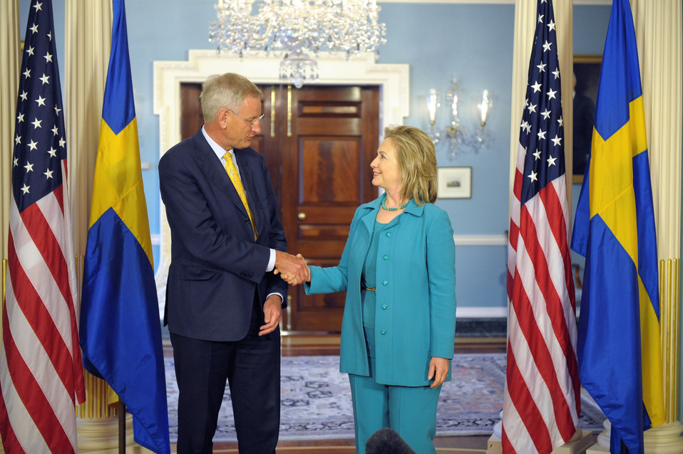 Secretary Clinton Shakes Hands With Swedish Foreign Minister Bildt