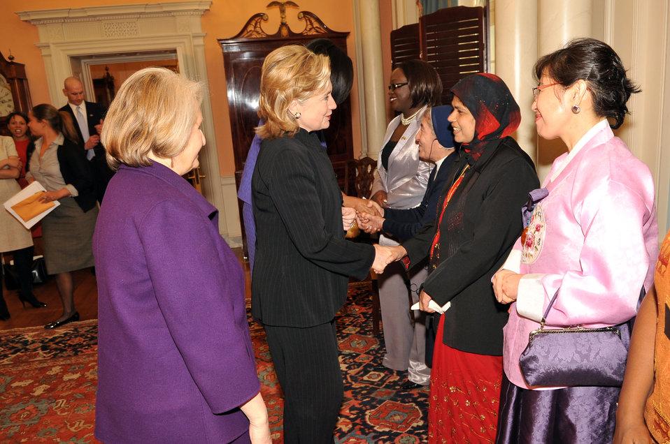 Secretary Clinton Shakes Hands With Honoree Jansila Majeed